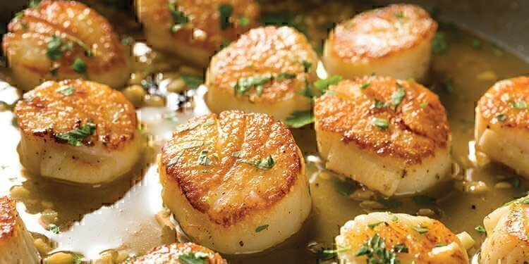 Wonderfully seasoned and cooked scallops that are about to be finished cooking.